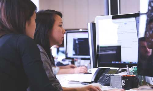 10 Configuration Management Tools Every Business Should Know About women computer - 10 Configuration Management Tools Every Business Should Know About